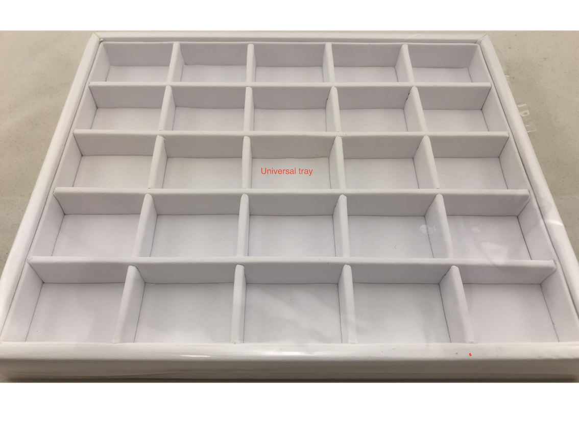 White leatherette tray with sections for gems